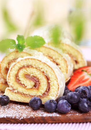 Swiss roll and fresh blueberries  photo
