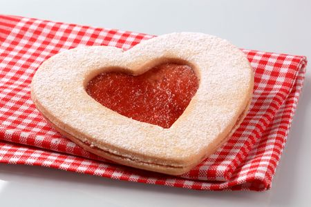 Heart shaped  Linzer cookie with jam filling  photo