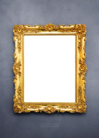 antique mirror: Ornate picture frame hanging on a wall Stock Photo