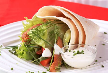 Tortilla wrap and a bowl of salad dressing Stock Photo - 6289361