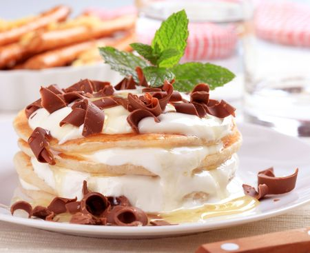 Pancakes with curd cheese topped with chocolate shavings