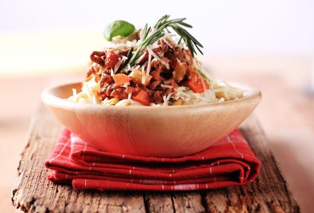 Bolognese sauce on a bed of spaghetti sprinkled with Parmesan photo