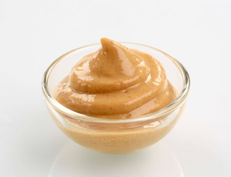 Swirl of spicy mustard in a bowl