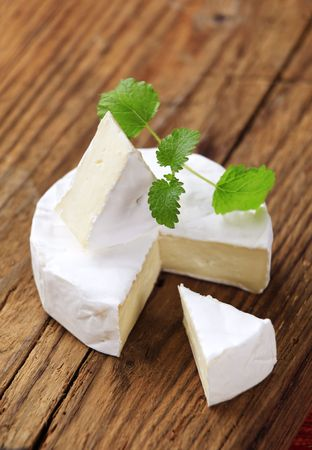 Soft cheese with edible white rind  photo