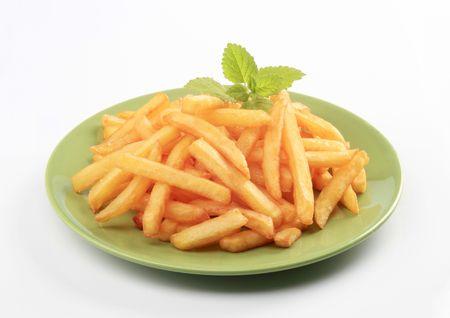 papas fritas: Mont�n de patatas fritas  Foto de archivo