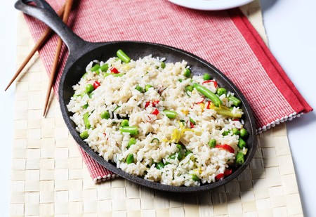 skillet: Rice and mixed vegetables stir fried in a skillet