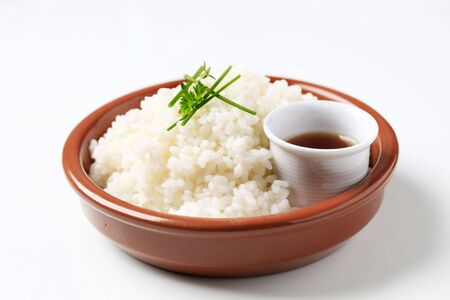 Rice and soy sauce photo