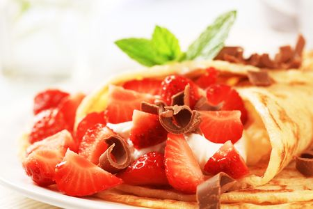 curd: Rolled up crepes with curd cheese and strawberries  Stock Photo