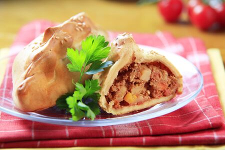 Cornish pasties filled with meat and vegetable photo