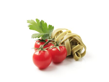 ribbon pasta: Cooked ribbon pasta and fresh tomatoes