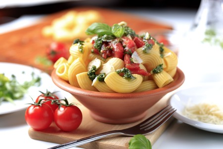 pasta dish: Macaroni with crushed tomatoes and pesto