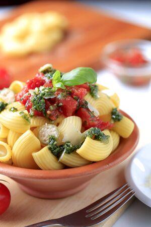 Macaroni with crushed tomatoes and pesto photo