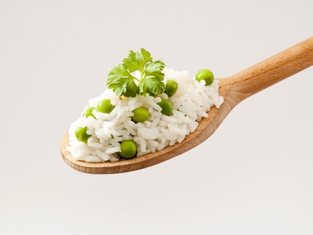 pulses: Rice and peas on a wooden spoon