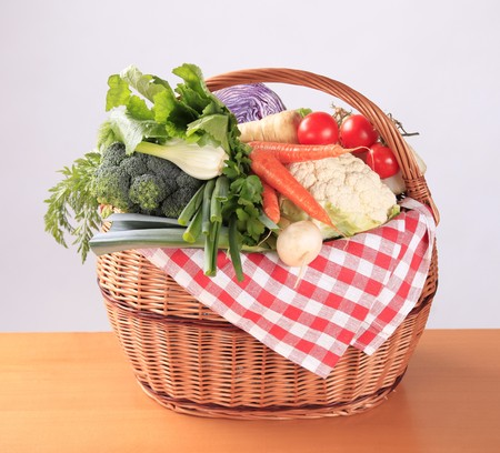 Variety of fresh vegetables in a basket photo