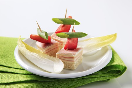 endive: Ham and cheese canapes and endive leaves