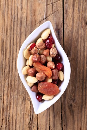 mixed nuts: Bowl of dried fruit and nuts Stock Photo