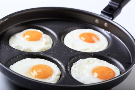 Four fried eggs - Sunny side up photo