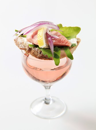 Tapa on a glass of rose wine photo