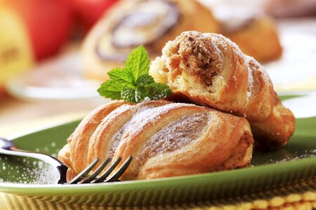 Sweet puff pastry rolls with nut filling photo