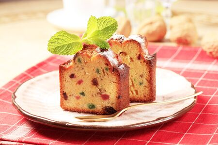 Slices of fruitcake on a pink porcelain plate photo