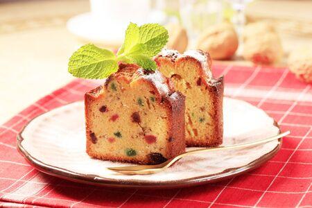 fruitcake: Slices of fruitcake on a pink porcelain plate Stock Photo