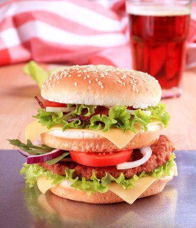 Hamburger with cheese and baked bacon - closeup Stock Photo - 7378114