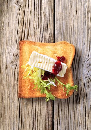 Toast and French cheese on wood - overhead photo