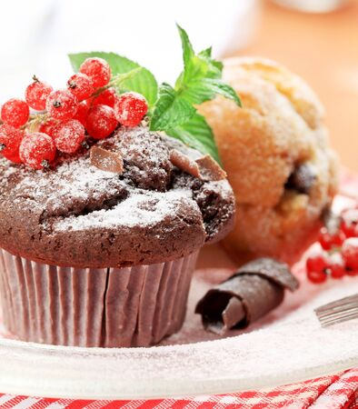 Fresh muffins styled with red currant - detail Stock Photo