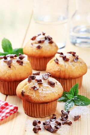 Four fresh muffins sprinkled with chocolate shavings  photo