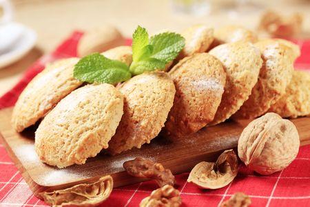 Walnut: Crisp cookies on a cutting board - closeup