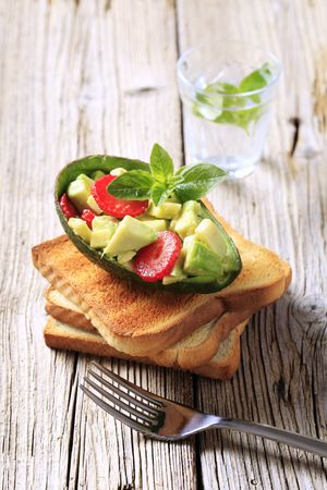 Avocado salad and toasted bread  photo
