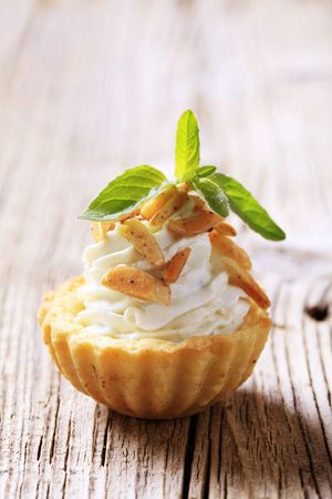 finger food: Canape - Tart shell with savory spread filling topped with roasted almonds