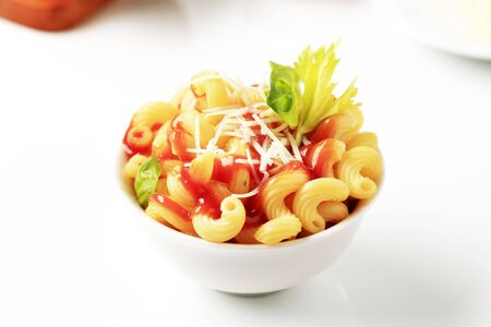 Macaroni with tomato sauce and cheese - detail photo
