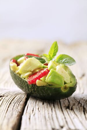Avocado salad served in an avocado peel photo
