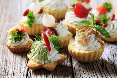 savory: Variety of pastry-based canapes with various toppings Stock Photo