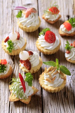 nibbles: Variety of pastry-based canapes with various toppings Stock Photo