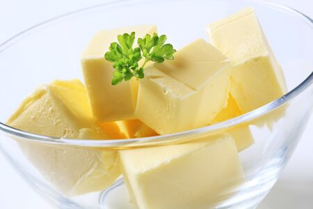 Lumps of fresh butter in a bowl