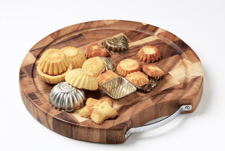 fluted: Tart shells and baking molds on a cutting board