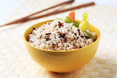 boiled: Bowl of cooked mixed rice - closeup Stock Photo