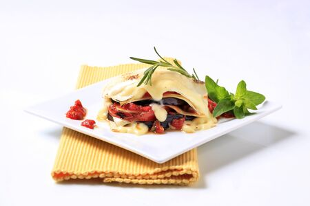 meatless: Tomato and aubergine lasagna topped with cheese sauce Stock Photo