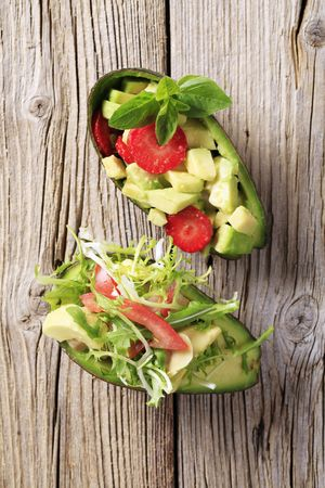 Avocado halves filled with avocado salads - closeup photo