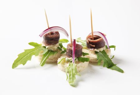 arugula: Anchovy canapes garnished with leaves of arugula
