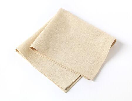 serviettes: Small folded linen napkin