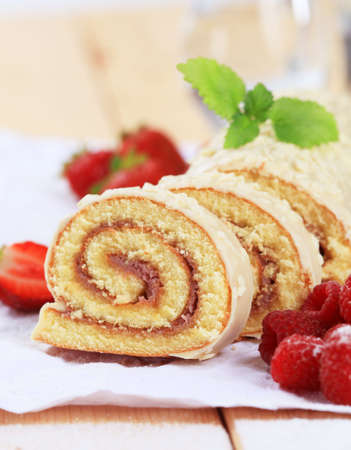 swiss roll: Slices of Swiss roll and fresh raspberries