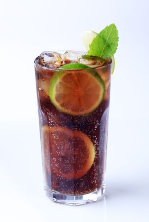 Iced drink with slices of lime and ice photo