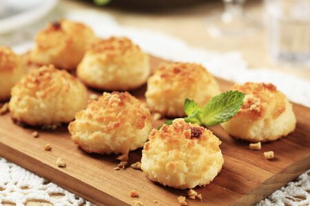 Crisp coconut macaroons on a cutting board photo