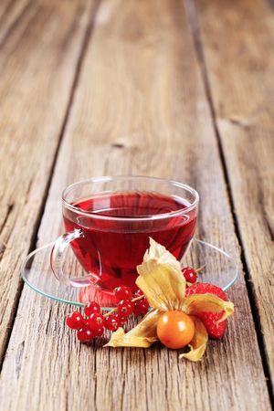 Fruit tea in a glass cup - closeup photo