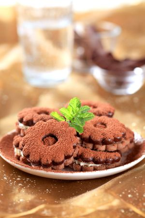 Chocolate sandwich cookies with cream filling - still life photo