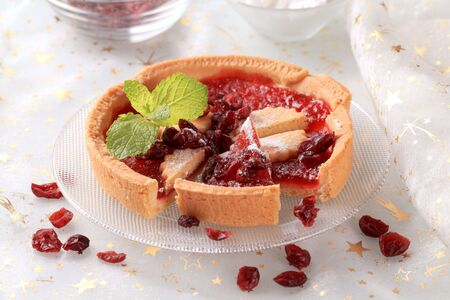 Sweet jelly tart sprinkled with dried fruit photo