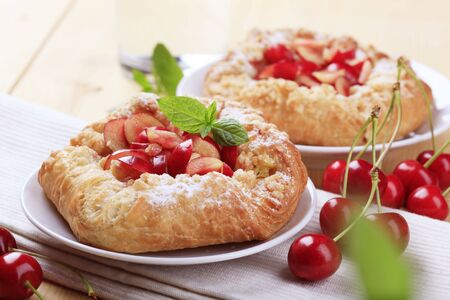 danish: Danish pastry with fresh cherries - closeup